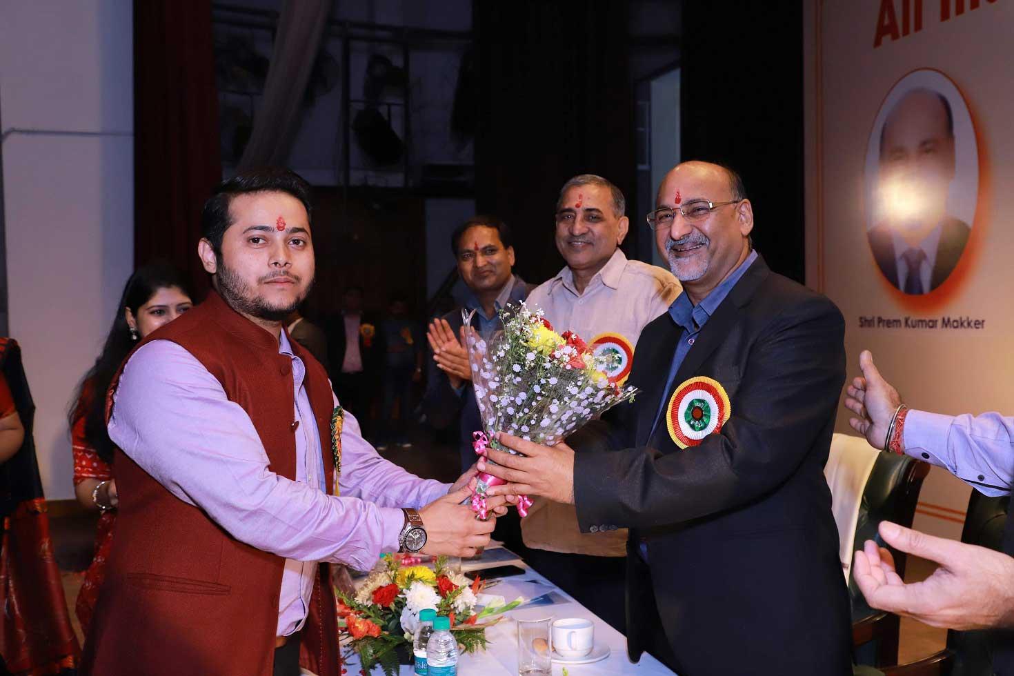 Mr KK Nair Taking bouquet by colleague