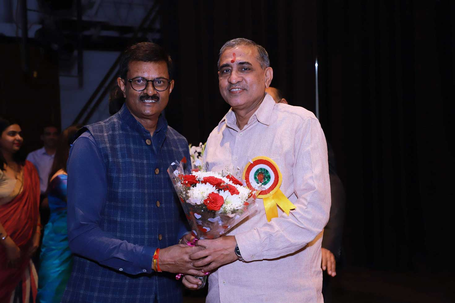 Mr RK Chatterjee receive flower bouquet